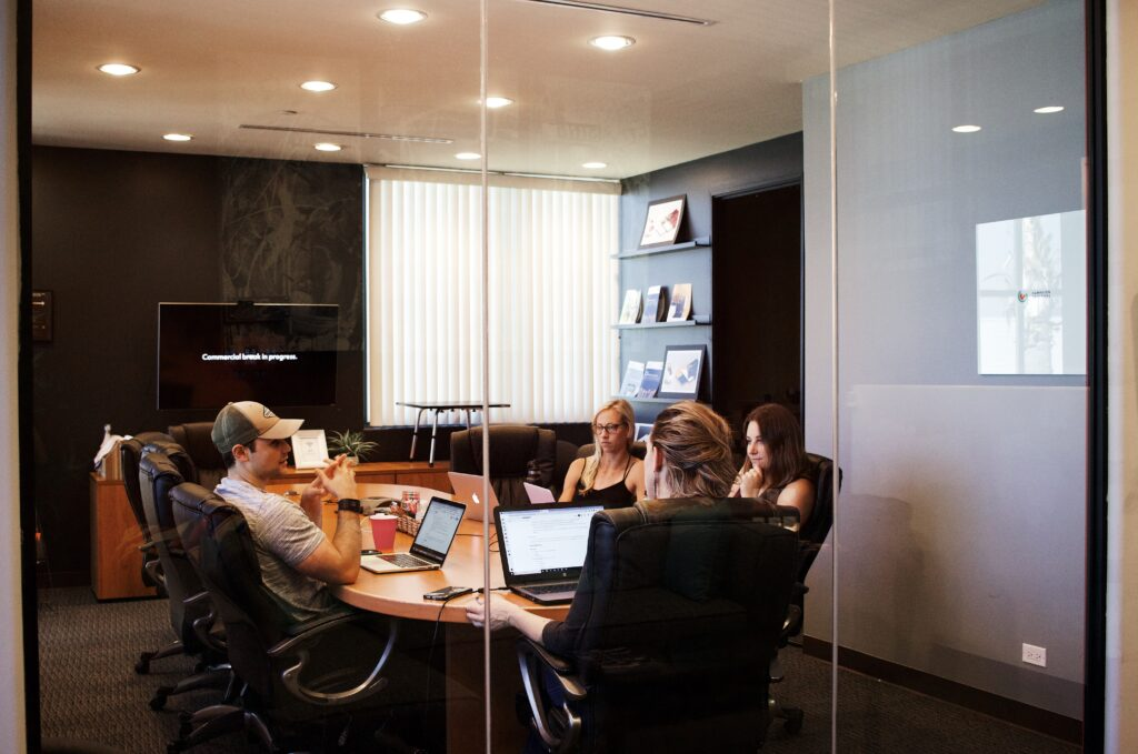 Employees hold a meeting in a conference room in Malta.