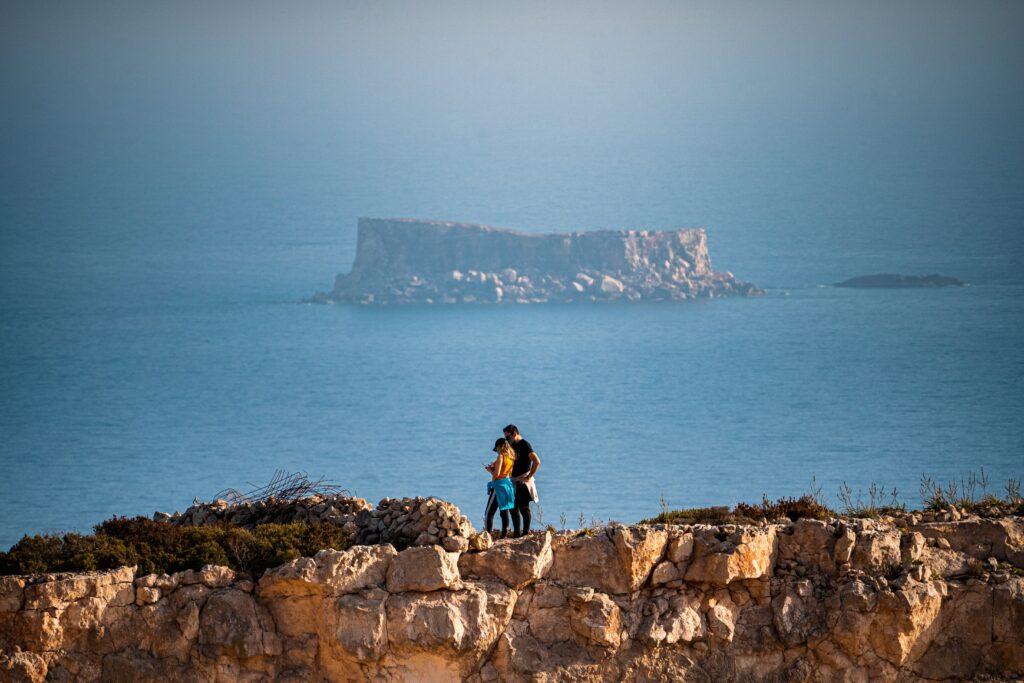 A view of neighbouring islands from Gozo's rocky coastline.