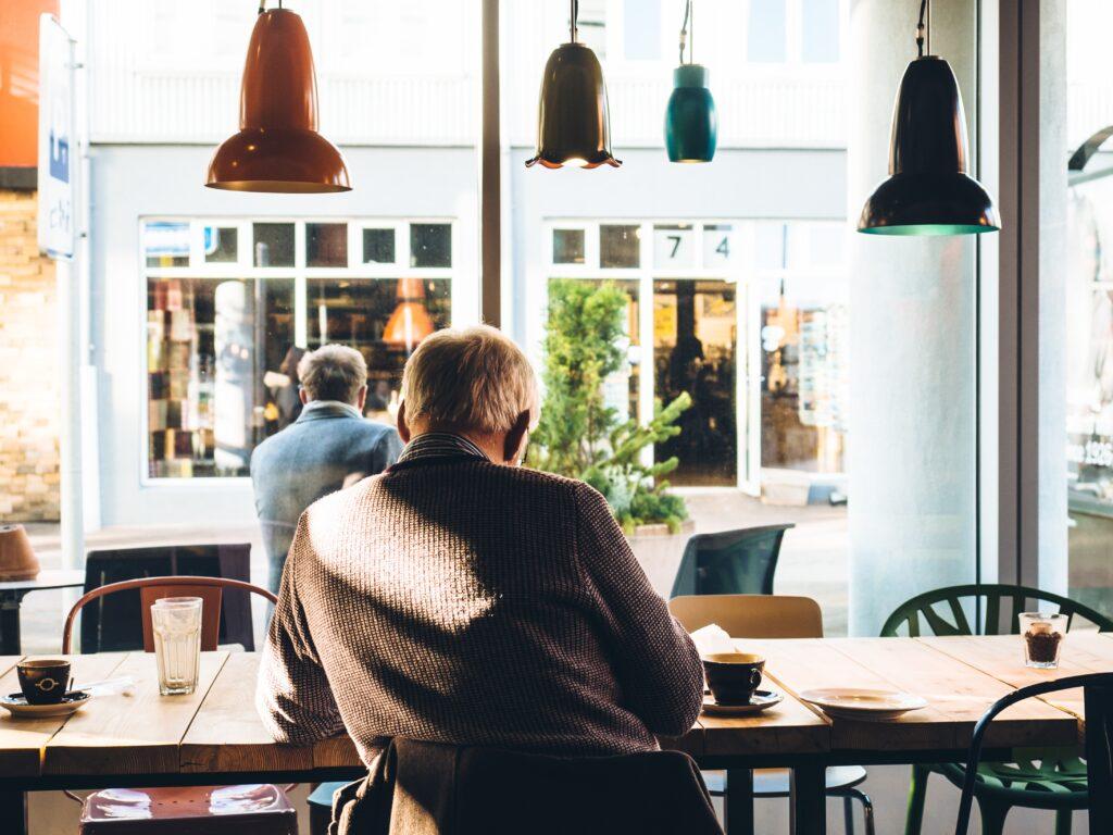 Senior in a Maltese Cafe